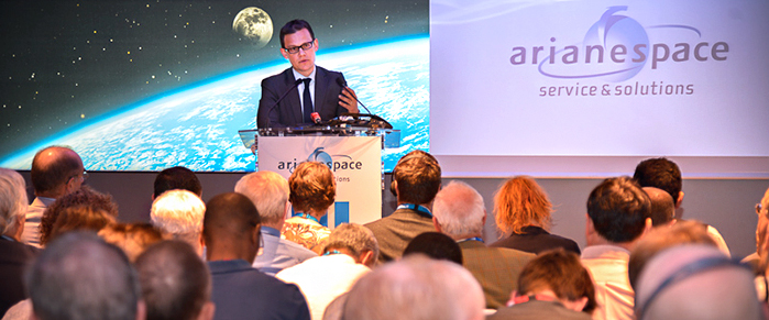 Stéphane Israël speaks to a capacity crowd of international reporters during Arianespace's Paris Air Show press conference, which was held in the company's hospitality chalet at Le Bourget Airport.