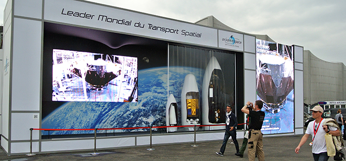 Arianespace's outdoor theater attracted attention throughout the Paris Air Show's opening day with its continuous showing of dual-screen movies and the display of scale model payload fairings for Ariane 5, Soyuz and Vega.