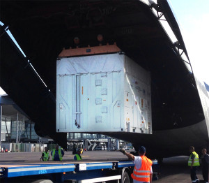 Protected by their shipping containers, the O3b Networks satellites are unloaded from the cargo jetliner after their delivery to French Guiana.