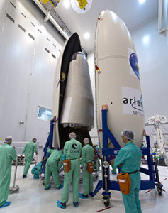 A perfect fit! Vega's two-piece payload fairing is closed around the Intermediate eXperimental Vehicle (IXV) by personnel working in the Spaceport's S5 facility.