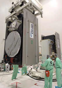 One of Soyuz' Galileo navigation satellite passengers is already installed on the payload dispenser system (seen in the background), as the second spacecraft is moved into position for its integration.