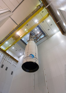 Ariane 5's upper payload section – composed of THOR 7 and its payload fairing – is raised inside the Spaceport's Final Assembly Building for installation atop the launcher.