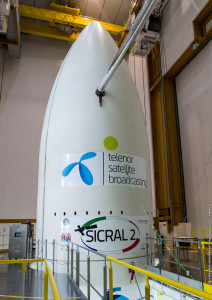 Logos for Flight VA222's two passengers are installed on the Ariane 5 payload fairing in this photo from the upper level of the Spaceport's Final Assembly Building.