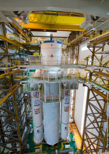 Ariane 5 is shown after completion of its initial build-up, with the combined cryogenic upper stage and vehicle equipment bay component integrated atop its core cryogenic stage.