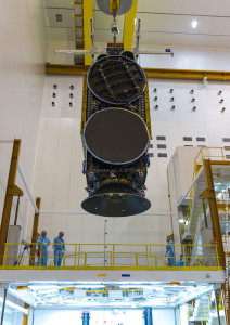 Star One C4 is lowered for its installation atop Ariane 5's SYLDA structure, which serves as the dispenser system for the heavy-lift launch vehicle's dual-satellite payload.
