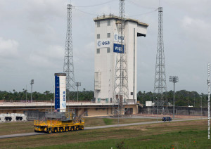Vega's P80 first stage for Arianespace Flight VV03 approaches the Spaceport's SLV launch complex on a transporter vehicle.