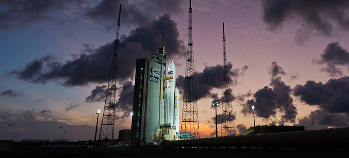 Framed against the French Guiana sunset, Ariane 5 is shown at the Spaceport with its heavyweight payload of ATV Georges Lemaître.