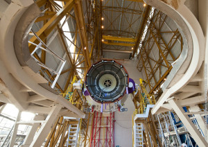 The Ariane 5 cryogenic core stage for Flight VA221 is readied to be raised into position over its mobile launch table to initiate the build-up activity.