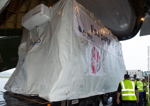 The protective shipping container with LISA Pathfinder is unloaded from an An-124 cargo jetliner at Cayenne's Félix Eboué Airport following the aircraft's landing this morning.