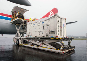 One of the two containers with Galileo satellites for Arianespace's upcoming Soyuz mission is unloaded from the cargo jetliner after its touchdown at Cayenne's Félix Eboué Airport.