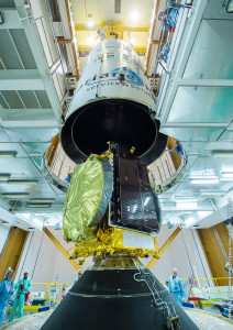 Flight VA227's upper component – consisting of Arabsat-6B, the Sylda dispenser system, and Ariane 5's protective payload fairing – is lowered over GSAT-15 during activity in the Ariane 5 Final Assembly Building.