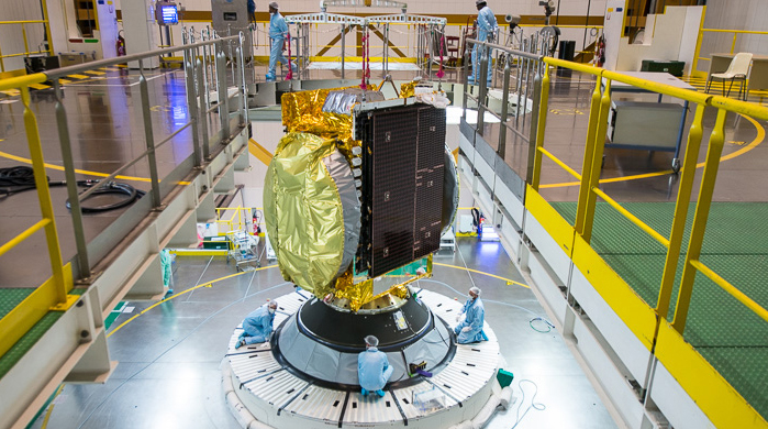 India's GSAT-15 is shown installed atop its Ariane 5 in the Final Assembly Building's upper level. With this passenger in place, the launcher was ready to receive Arabsat-6B, which previously was integrated in Ariane 5's payload fairing along with the Sylda dispenser system.