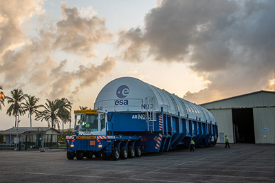 After being unloaded from the MN Colibri sea-going ship at Pariacabo Port, Ariane 5's core cryogenic stage for Flight VA229 is readied for the transfer by road to the nearby Spaceport.