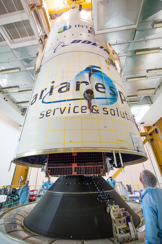 The encapsulation of Intelsat 29e in its protective payload fairing is completed during activity inside the Spaceport's Final Assembly Building for Ariane 5.