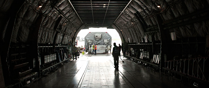 Alphasat was delivered to French Guiana aboard a chartered Antonov An-124 jetliner. This view is from inside the aircraft as Alphasat is moved out for its transfer by road to the Spaceport.