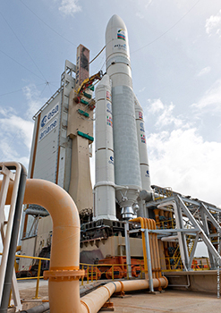 The Ariane 5 with its Azerspace/Africasat-1a and Amazonas 3 satellite passengers is shown in the Spaceport's ELA-3 launch zone. Visible in the foreground is a pipe for the water deluge system that provides acoustic damping during the launcher's engine ignition and at liftoff.