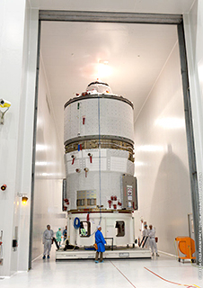 At the Spaceport in French Guiana, the ATV Albert Einstein payload for Arianespace Flight VA213 is moved into the S5B high-bay area on an air cushion pallet for its final pre-launch preparations.