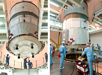 ATV Albert Einstein is lowered into position for integration with its Ariane 5 launcher inside the Spaceport's Final Assembly Building as preparations near completion for next month's mission.