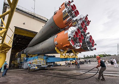 Soyuz rolls out from the MIK launcher assembly facility to the ELS launch zone