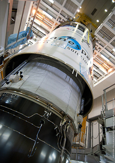 The Ariane 5's payload fairing is lowered into position over the ATV Edoardo Amaldi for a second time during activity in the Spaceport's Final Assembly Building.