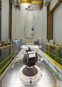 The encapsulated Intelsat 20 satellite is ready for lowering into position over HYLAS 2, which previously was installed atop Arianespace's Ariane 5 to be launched on August 2.