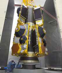 Globalstar's second-generation satellites are shown on their dispenser at Baikonur Cosmodrome, where the cluster of six spacecraft will be orbited December 28 by a Soyuz on Flight ST24 performed on behalf of Arianespace by its Starsem affiliate.