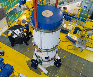 Vega's solid-propellant third stage is installed on top of the launcher earlier this month in French Guiana as this new lightweight vehicle is readied for its maiden flight from the Spaceport in 2012.