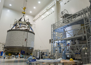 The Integrated Cargo Carrier section (at left) is hoisted for mating this week with the Service Module (partly visible at right) of Europe's no. 3 Automated Transfer Vehicle, which will be launched in March 2012 by an Ariane 5.