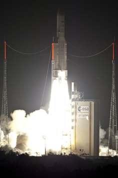 Powered by its Vulcain cryogenic main engine and two solid propellant boosters , Ariane 5 clears the launch tower with the dual-passenger payload of Arabsat-5C and SES-2.