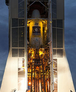 The no. 1 Soyuz for launch from French Guiana is seen through the open doors of its mobile service gantry.