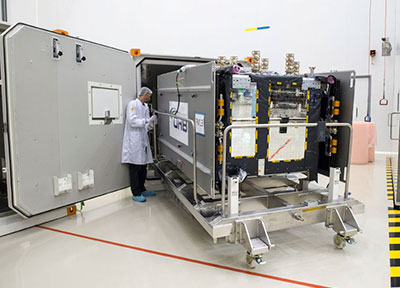 One of four Galileo satellites for launch on Ariane Flight VA233 is removed from its protective shipping container