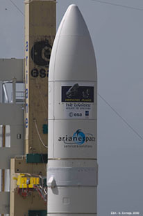 "Logos on the 17-meter-long Ariane 5 payload fairing include depictions of the Herschel and Planck, as well as the slogan: ""The universe - yours to discover."""
