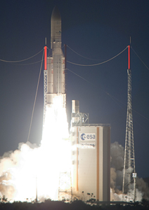 Ariane 5 begins its ascent with the mission's dual satellite payload, which weighed approximately 7,400 kg.
