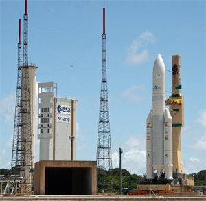 The heavy-lift Ariane 5 completes its rollout – approaching the Spaceport's ELA-3 launch zone at left, where it was locked in position for tomorrow's liftoff with the W3B and BSAT-3b satellites.
