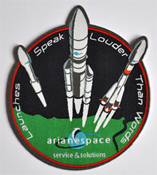 "Arianespace's ""Launches speak louder than words"" patch was a popular item with attendees at the World Satellite Business Week in Paris."