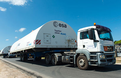 Ariane 5's payload fairing half-shells are transferred to the Spaceport