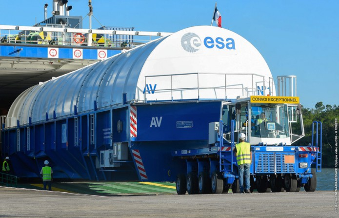The Ariane 5 EPC stage for Flight VA235 is unloaded for its transfer to the Spaceport