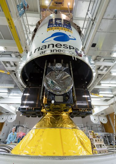 The Ariane 5 payload fairing is lowered over the four Galileo satellite passengers, which are installed atop the launcher's central core.